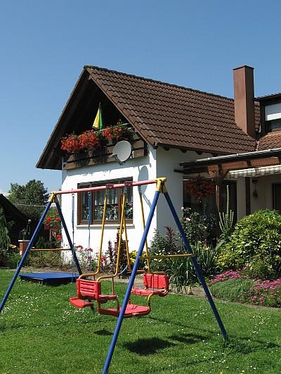 Ferienwohnung mit Balkon - Das Wohn- und Esszimmer